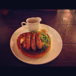 Bangers and mash, and peas in Yorkshire Pudding.