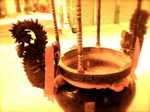 The urn outside the temple where I put my first incense offerings.