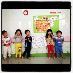 Some of my students holding up a birthday sign for my friend back home.