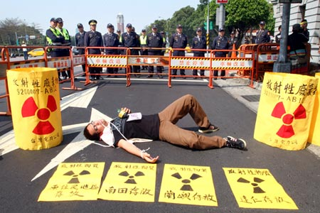 A man puts on a skit about the dangers of nuclear energy at the protest.