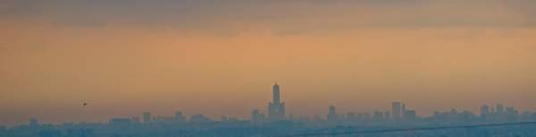 View of Kaohsiung City from 50 KM away. The tall tower is the 85 Tower.